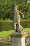 The statue of Neptune in the T-Canal in the Dutch influenced water garden at Westbury Court Garden, Gloucestershire, UK