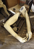 A jumble of items including loose arms from a mannequin, in the 1970s tailor's shop at the Birmingham Back to Backs