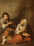 AN URCHIN MOCKING AN OLD WOMAN EATING MIGAS, after Bartolomé Esteban Murillo (Seville 1617 - Seville 1682), an eighteenth-century copy, at Dyrham Park.
