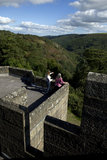 Visitors admiring the view over the countryside from the roof at Castle Drogo, Devon.