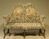 Early C18th walnut settee with needlework upholstery at Canons Ashby in the Tapestry Room
