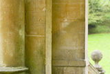 A close view of the C18th columns of the Palladian Bridge at Prior Park, Bath, UK, showing grafitti