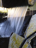 Water flowing into the water wheel which powers  Finch Foundry, which made hand tools for mining and agriculture in the C19th and C20th