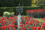 Red dahlias and an armillary sphere in the walled garden (previously the lavender garden area) at Polesden Lacey in October