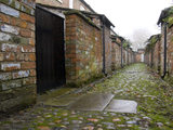 The back alley at Oak Cottages, part of the estate at Quarry Bank Mill, Styal