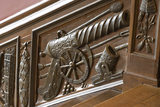 Close view of part of the panelling of the Great Staircase at Ham House, Surrey with the balustrade carved with trophies of war