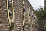 Busts of Roman Emperors in niches in the wall of the North Forecourt at Ham House, Surrey