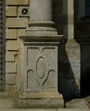 A detailed close up of the bottom of one of the pillars that stand at the entrance of the South Front of Felbrigg Hall