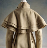 View of the back of a woman's wool caped coat, c.1820-30