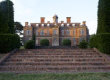 The south elevation of the Hall silhouetted against the sky taken from the foot of the brick steps in front