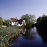 Distant view of Willy Lott's House, early C17th, on the River Stour at Flatford Mill