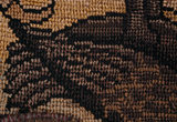 The hind quarters and tail of a bird from a motif on the Marian Needlework at Oxburgh Hall