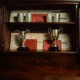 (FL) Prize cups and certificates which Beatrix won for sheep at local shows are housed in her husband's old offices; now the Beatrix Potter gallery in Hawkshead