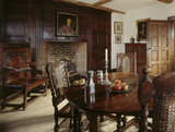 "Partial view across Mr.Whitgreave's Room at Moseley Old Hall. Over the fireplace is a portrait of Thomas Whitgreave, later known as ""The Preserver"" for his part in sheltering King Charles II."