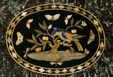 Detail of centre oval on rectangular pietra dura table top depicting rare butterflies, in the Drawing Room at The Argory