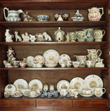 (FL) China in the Sitting Room cabinet at Hill Top, including a Wedgewood tea service decorated with scenes from the 'little books' and a dolls tea set from about 1810