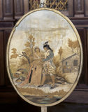 A pole screen, c.1790, depicting a man talking to a woman in a pastoral scene, in the Blue Drawing Room at Melford Hall.