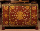 Close-up of the elaborately painted Indian red lacquer bridal chest in the Study at Bateman's