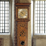 Closeup of the late C17th. long case clock by Ben Merriman in the Entrance Hall of the Treasurer's House