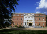 The west front of Clandon House with the entrance steps & porte- cochere added in 1876