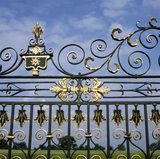 A close-up detail of the wrought iron gate of Erddig