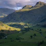 View of Great Langdale from the fell above Chapel Stile, showing Great Langdale Beck in the valley with the outline of the Langdale Pikes beyond