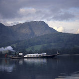 Coniston Water, view of the steam gondola on the lake, with the fells behind, in the Lake District, Cumbria