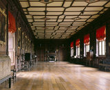 View of the Long Gallery at Chirk Castle showing the carved woodwork and panelled ceiling