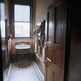 The Gentleman's Cloakroom at Sunnycroft, showing the original wash-basin, clothes hooks and towel rail