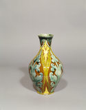 Della Robbia vase with patterns of green, brown and yellow, in the Morning room