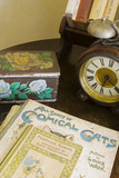 A close view of an alarm clock and some children's periodicals, in Honora's Bedroom at Plas yn Rhiw, Pwllheli, Gwynedd
