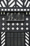 Windows and black & white timberwork on the south front at Speke Hall, Merseyside