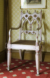 Neo-Gothic chair painted with Disraeli's colours, made by Messrs Skull of High Wycombe, in the Disraeli Room at Hughenden Manor, Buckinghamshire, home of prime minister Benjamin Disraeli between 1848 and 1881