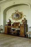 The ebony-inlaid mahogany sideboard in the style of Thomas Hope, in an alcove of the Dining Room at Hinton Ampner, Hampshire