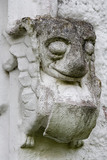 Scaled creature, part of the stonework on the east front at Bradley Manor, a medieval manor house at Newton Abbot, Devon