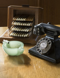 Telephone, ash tray and cigarette holder on the desk top in the Library at Coleton Fishacre, the house designed in 1925 for Rupert and Lady Dorothy D'Oyly Carte at Kingswear, Devon