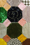 Close view of a Victorian patchwork quilt covering the bed in Honora's Bedroom at Plas yn Rhiw, Pwllheli, Gwynedd
