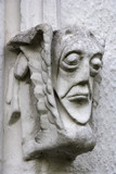 Grotesque face on east front of Bradley Manor, a medieval manor house at Newton Abbot, Devon