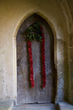 Christmas decorations on the wooden door at the Christmas fair at Lacock Abbey, near Chippenham, Wiltshire