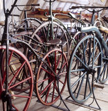 Some of the 'boneshaker' bicycles of 1870-85 in Hundred Wheels, at Snowshill Manor