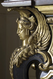 Ormolu winged sphinx on the left side of the Boulle commode in the Carved Room at Petworth House, West Sussex