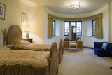 The Turret Bedroom with beds and dressing table at Coleton Fishacre, the house designed in 1925 for Rupert and Lady Dorothy D'Oyly Carte at Kingswear, Devon