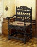 An ebony 'Tudor' chair that orginally stood in the entrance hall at Charlton, now at Tyntesfield