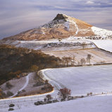 Looking across the snowy fields to the pinnacle of Roseberry Topping