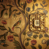 An illuminated miniature of Christ & his Disciples hangs on the 18th century English 'Cordoba' leather in the Dining Room