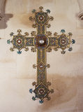 Close view of a highly decorative cross in Gothic medieval style on the wall in the Chapel at Tyntesfield