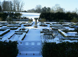 A view of the Jekyll Garden at Hatchlands Park, taken in January with a thick layer of snow on the ground