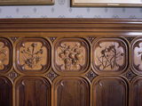 Lord Wraxall's Sitting Room at Tyntesfield: detail view showing close-up of the carved walnut and fruit wood dado panelling depicting flower arrangements