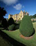 The east front of Montacute House, seen through the Irish yews, that line the North Garden, Somerset