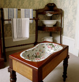 The Corner Dressing Room at Berrington Hall showing a Spode bidet set in a wooden table frame, with a towel rack and washstand nearby